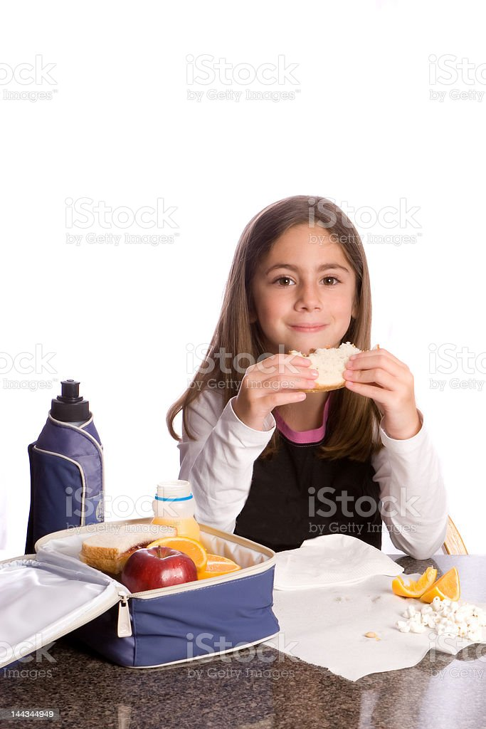 young girl enjoying her lunch royalty-free stock photo