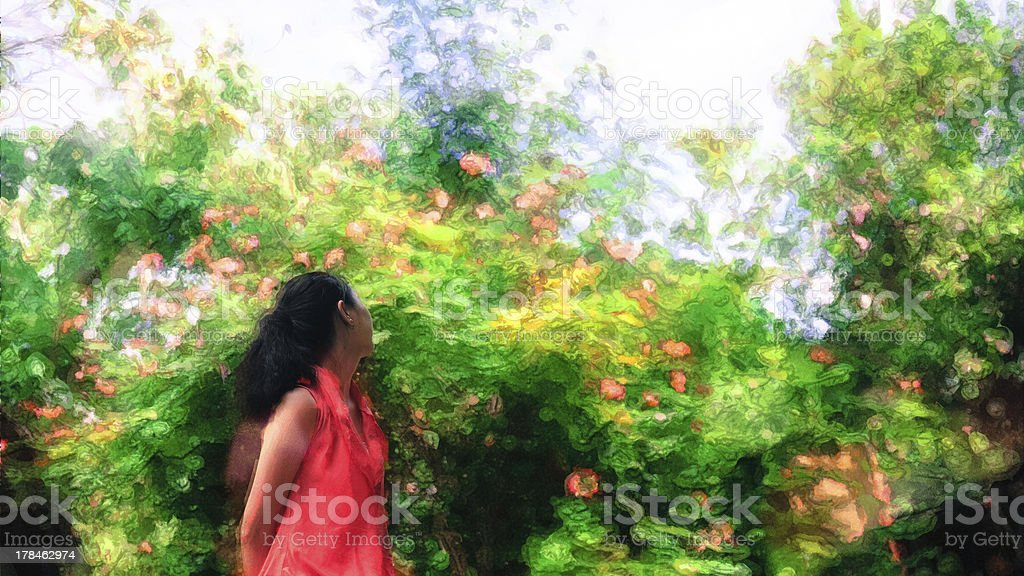 young girl enjoys herself looking at flowers and trees royalty-free stock photo