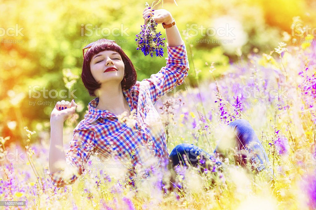 Young girl enjoys in flourishing field of solar royalty-free stock photo
