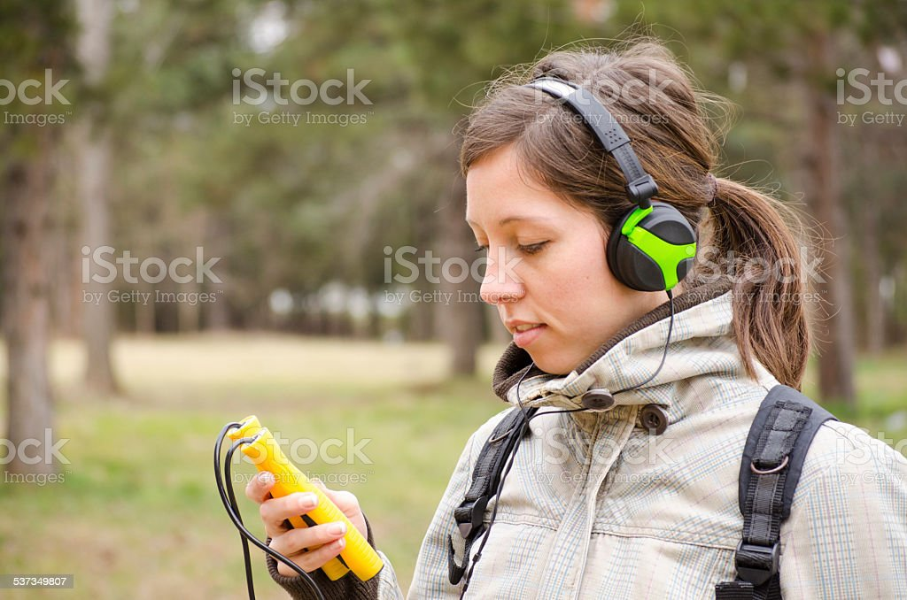 Young girl exercising and listening to music royalty-free stock photo