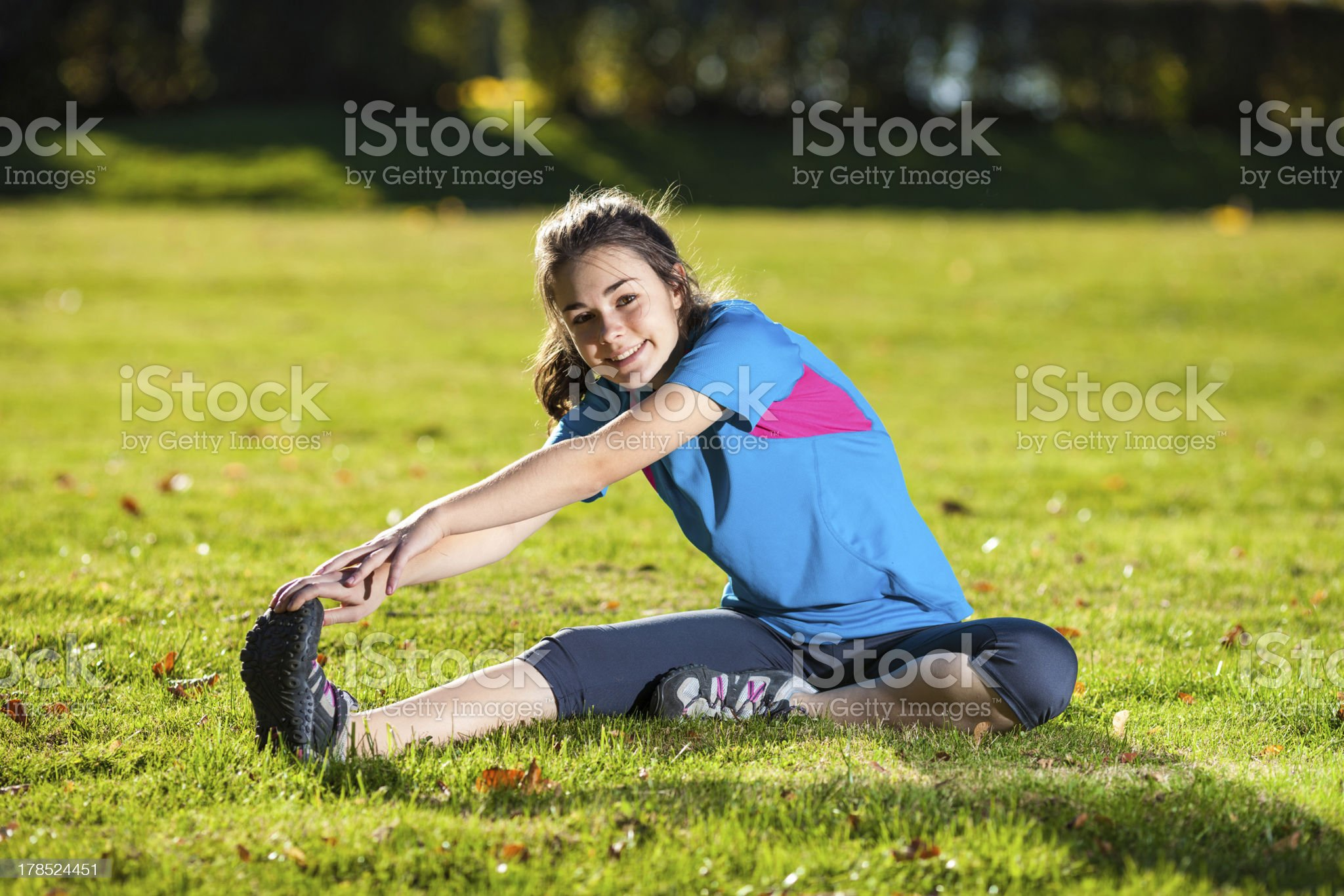 Young girl exercising outdoor royalty-free stock photo