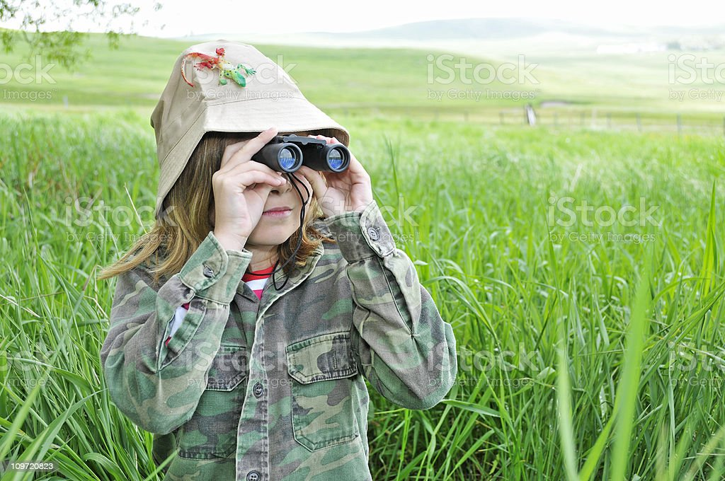 Young girl explores nature with binoculars royalty-free stock photo