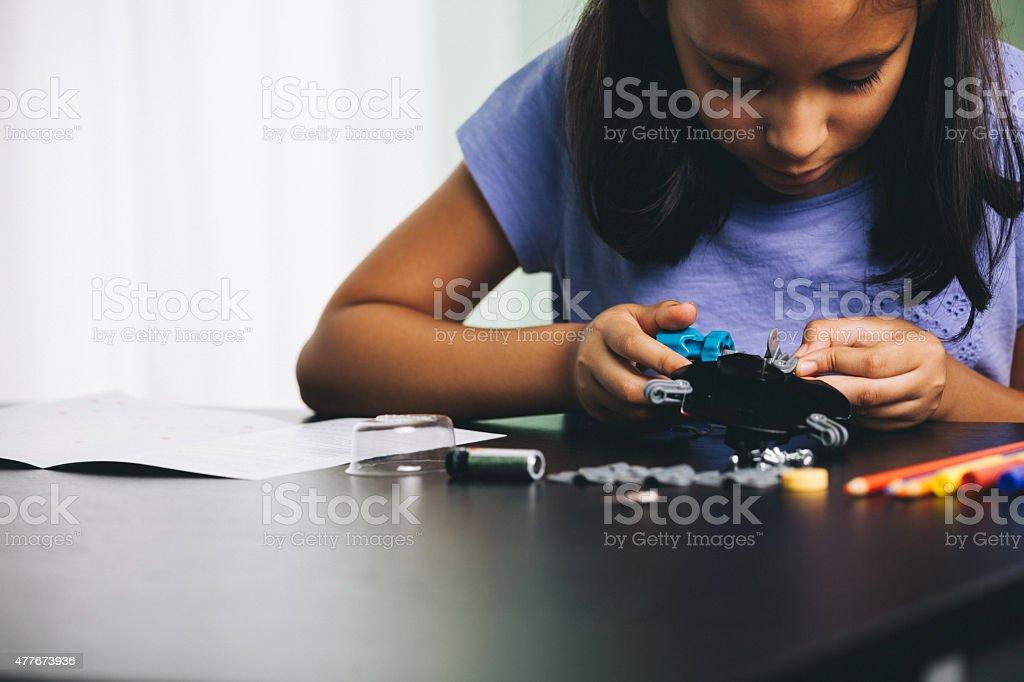 young girl exploring robotics stock photo