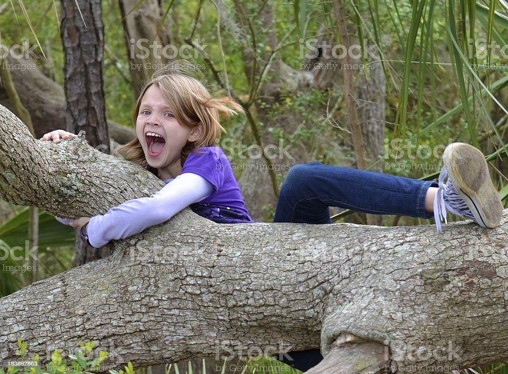 Young girl falling from a tree. royalty-free stock photo