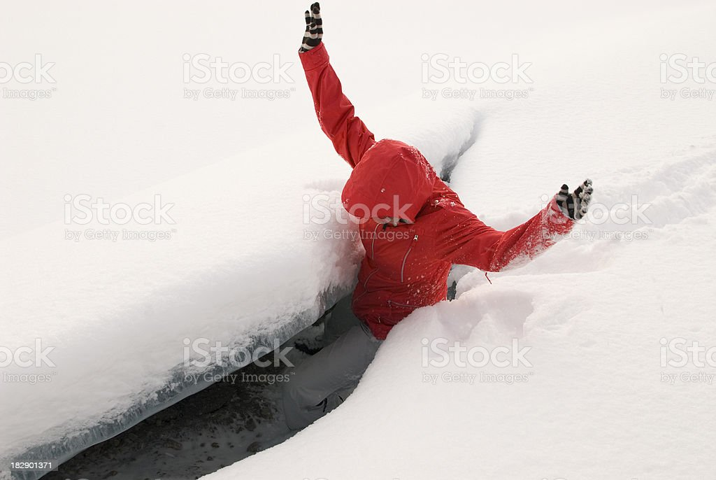 Young girl falls into a crevasse royalty-free stock photo