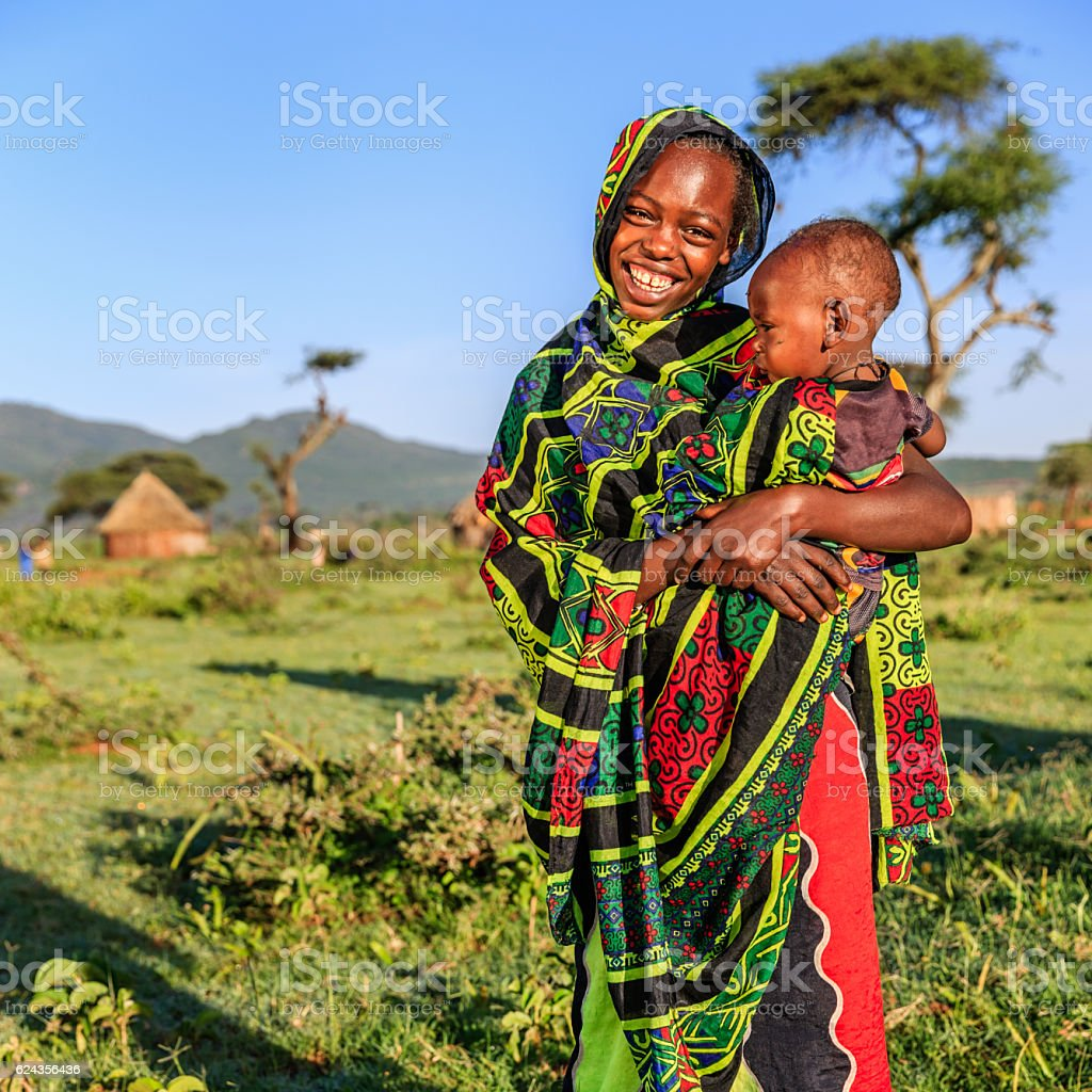 Young girl from Borana tribe holding baby, Ethiopia, Africa stock photo