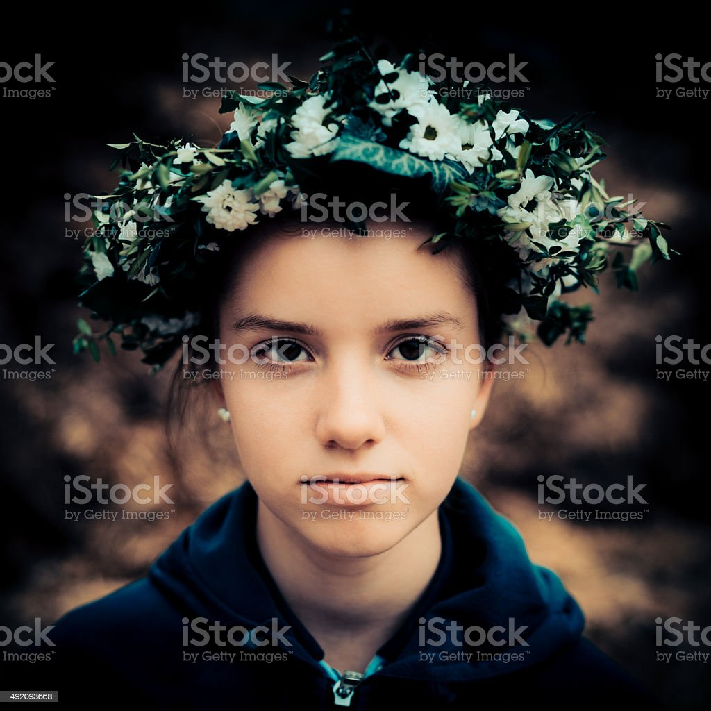 Young Girl Garland Floral Wreath Portrait stock photo
