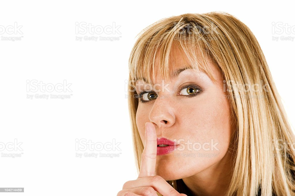 young girl gestures for silence royalty-free stock photo