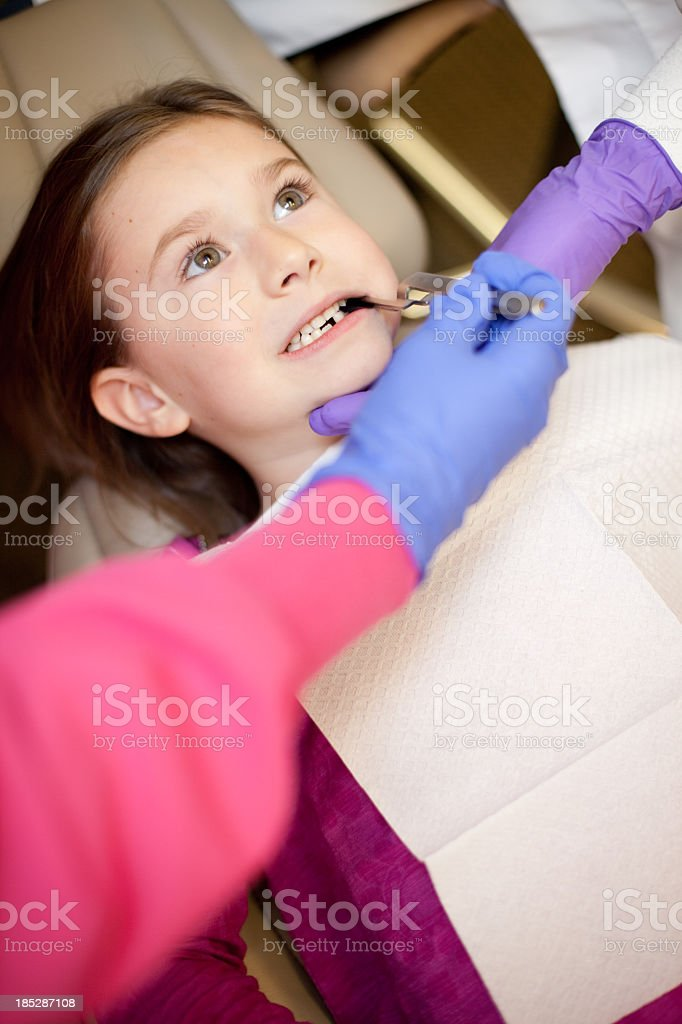 Young Girl Getting Cavity Filled by Dentist at Dental Office royalty-free stock photo