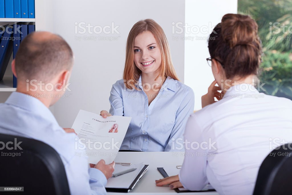 Young girl gives her CV stock photo