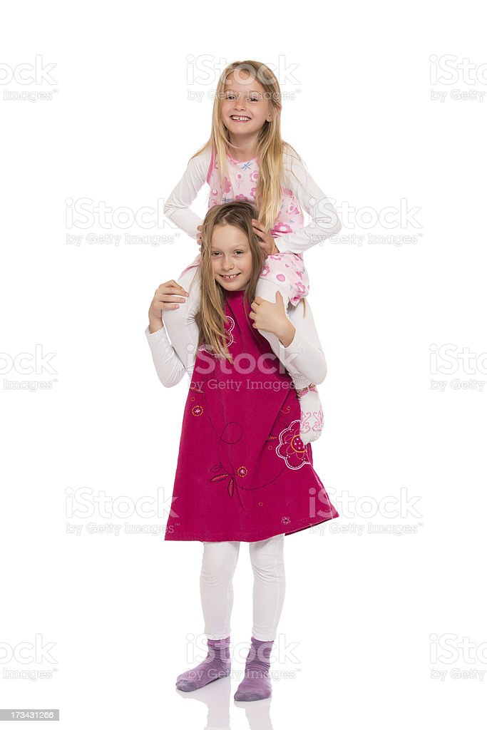 Young girl giving piggyback ride royalty-free stock photo