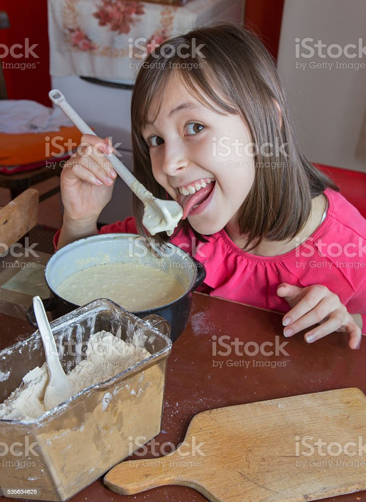young girl gustation at the cooking stock photo