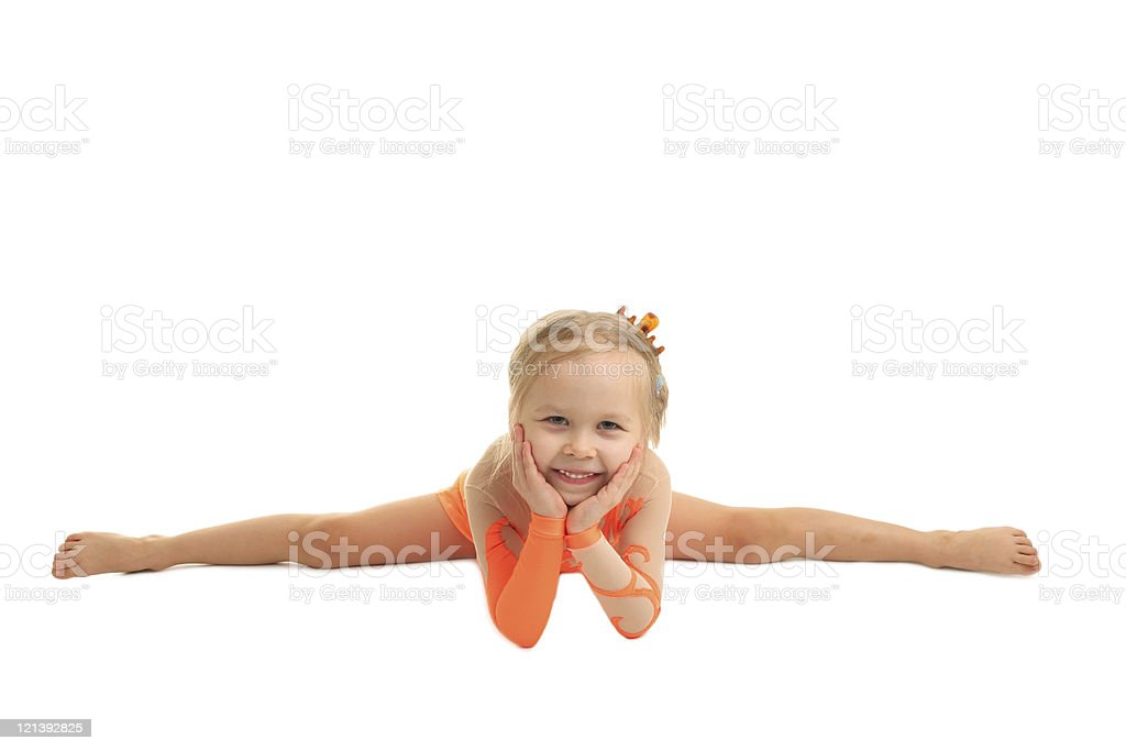 A young girl gymnast in a straddle split holding her face  royalty-free stock photo