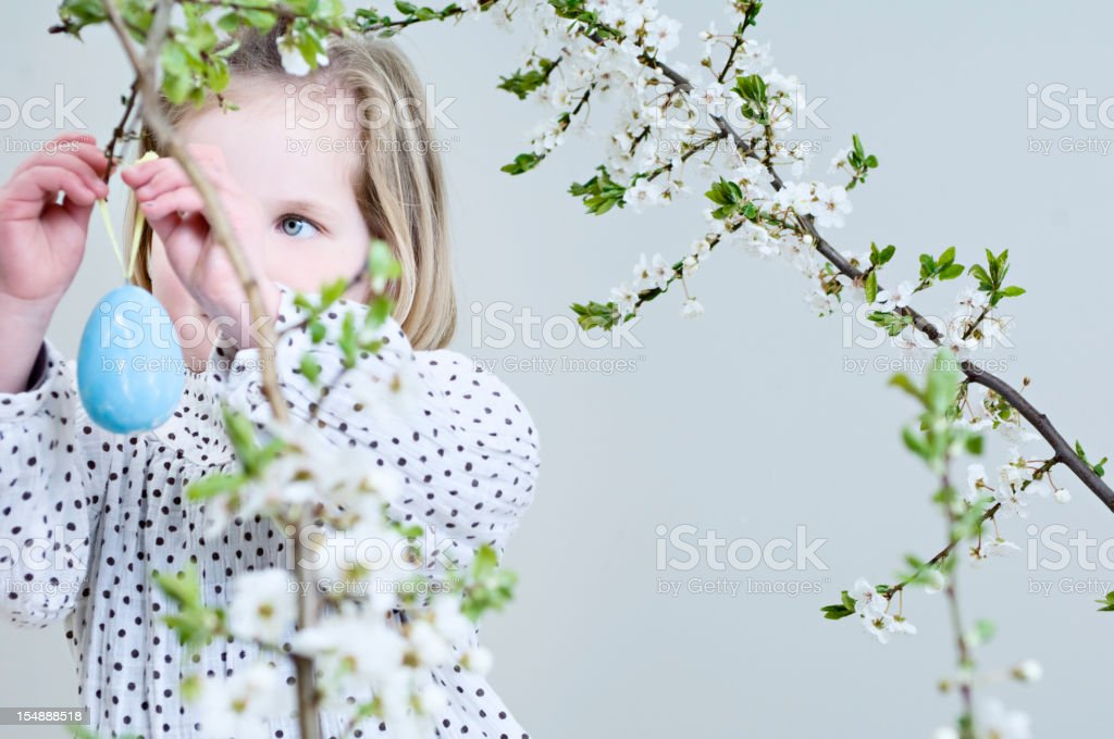Young Girl Hanging Easter Decorations. royalty-free stock photo