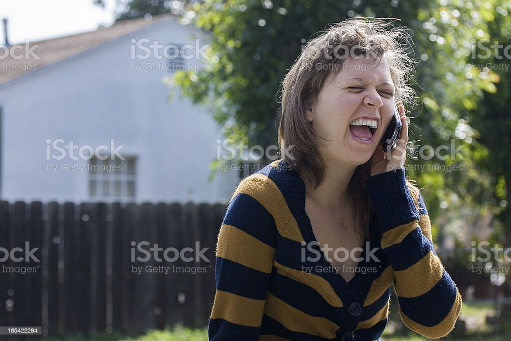 Young Girl Happily Chats On Cellphone royalty-free stock photo