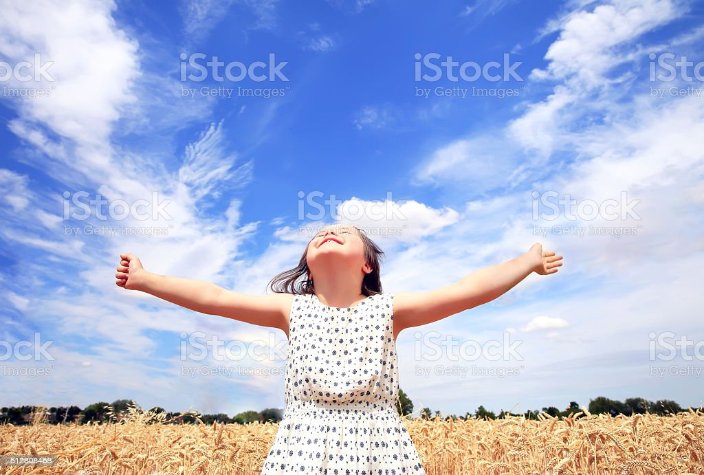 Young girl have fun in wheat field stock photo