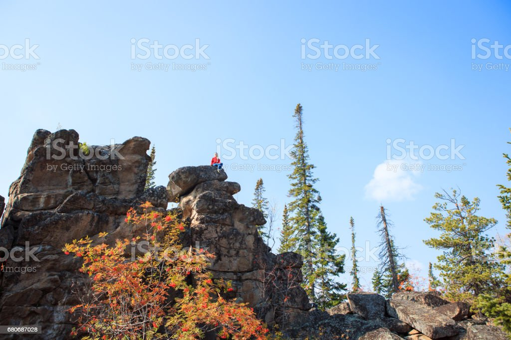 Young girl having a rest at the top of the mountain. Calm concept. Meditation. Nature loving stock photo