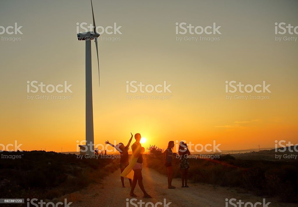 Young girl having fun at sunset stock photo