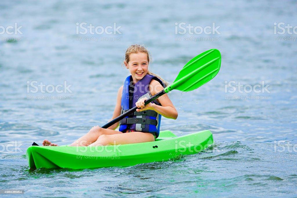 Young Girl Having Fun Kayaking stock photo