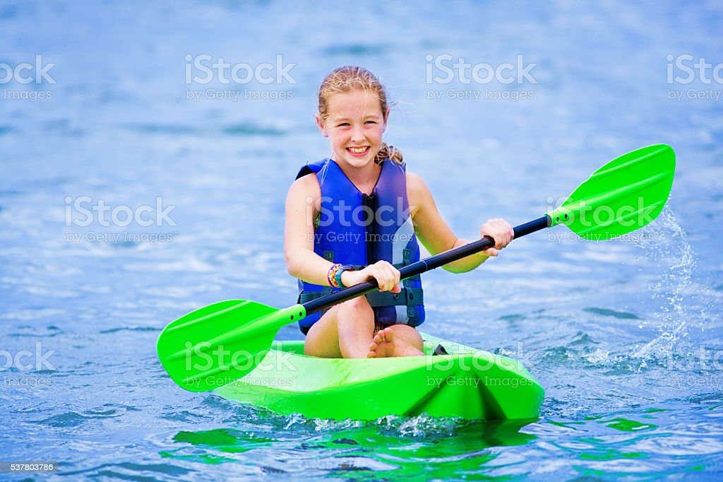 Young Girl Having Fun Kayaking stock photo