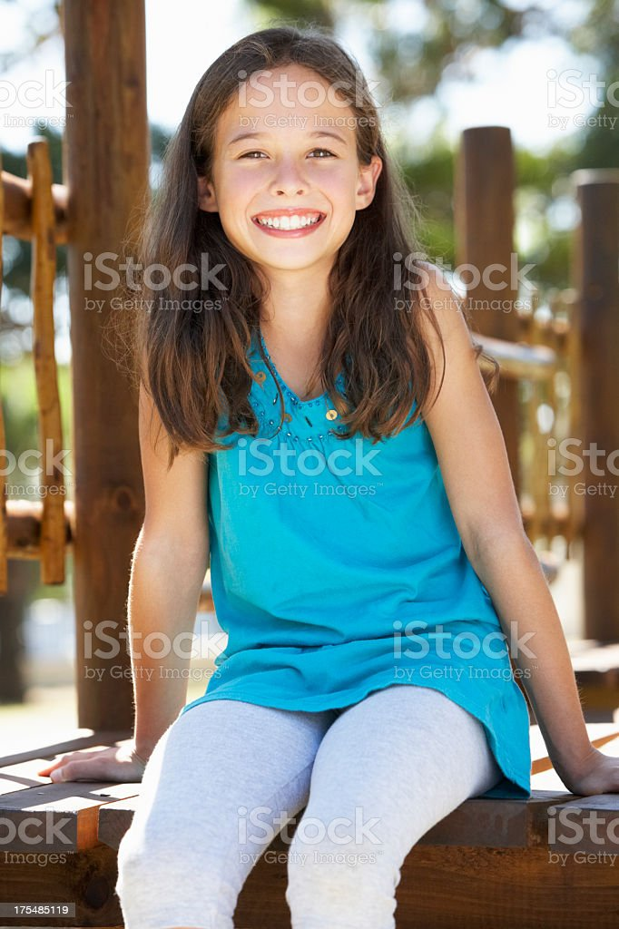 Young Girl Having Fun On Climbing Frame royalty-free stock photo