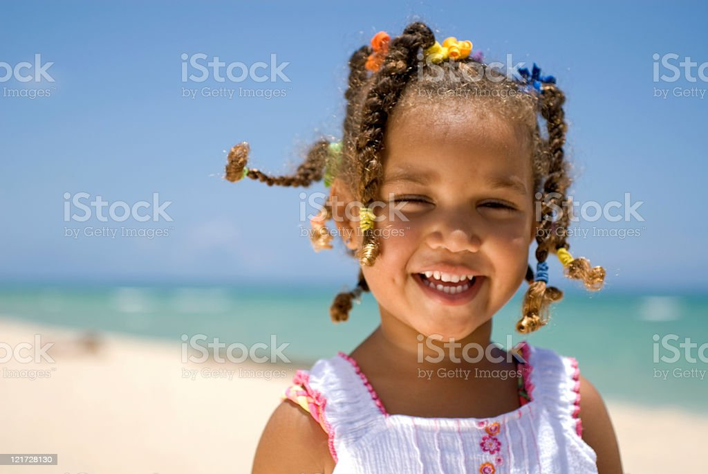 A young girl having fun on the beach royalty-free stock photo
