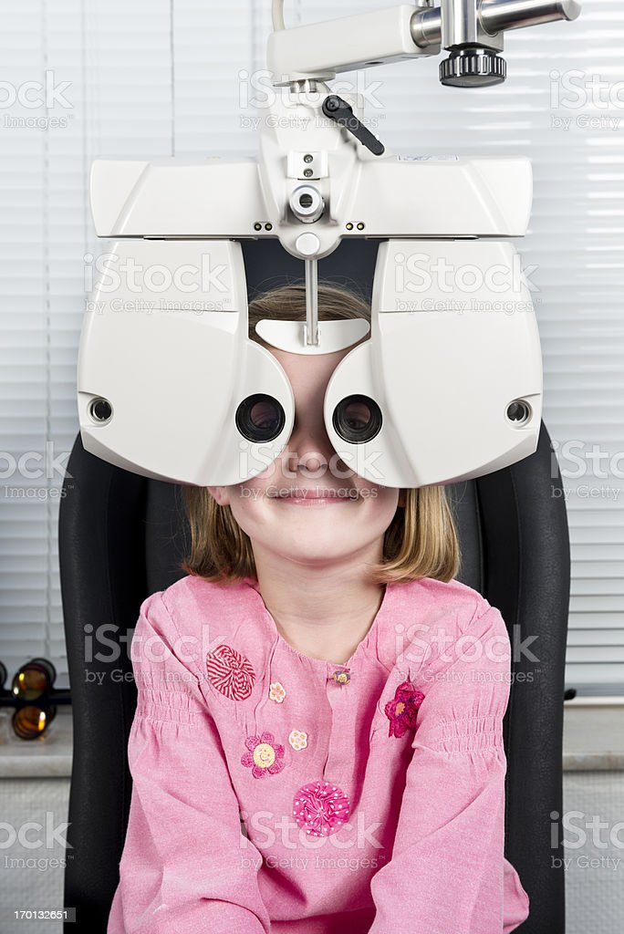 Young Girl Having Her Eyesight Checked royalty-free stock photo