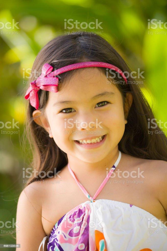 Young girl Hawaiian Polynesian Children in Tradition Clothing stock photo