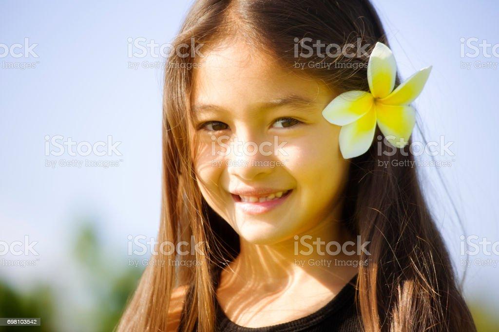 Young girl Hawaiian Polynesian Children with Flower stock photo