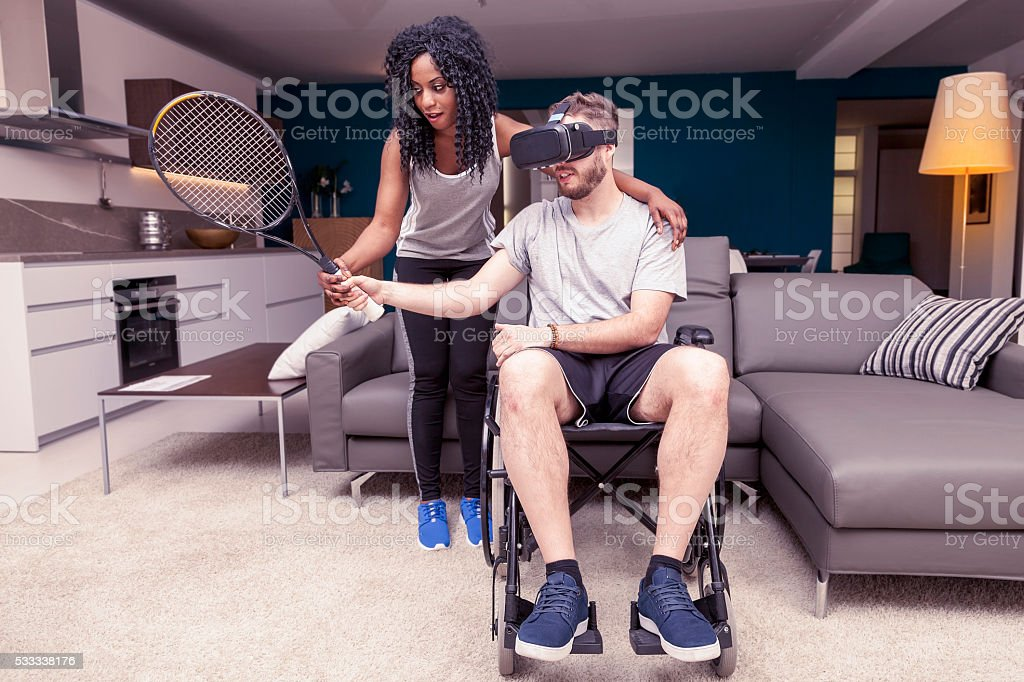 young girl helps a disabled who plays tennis stock photo