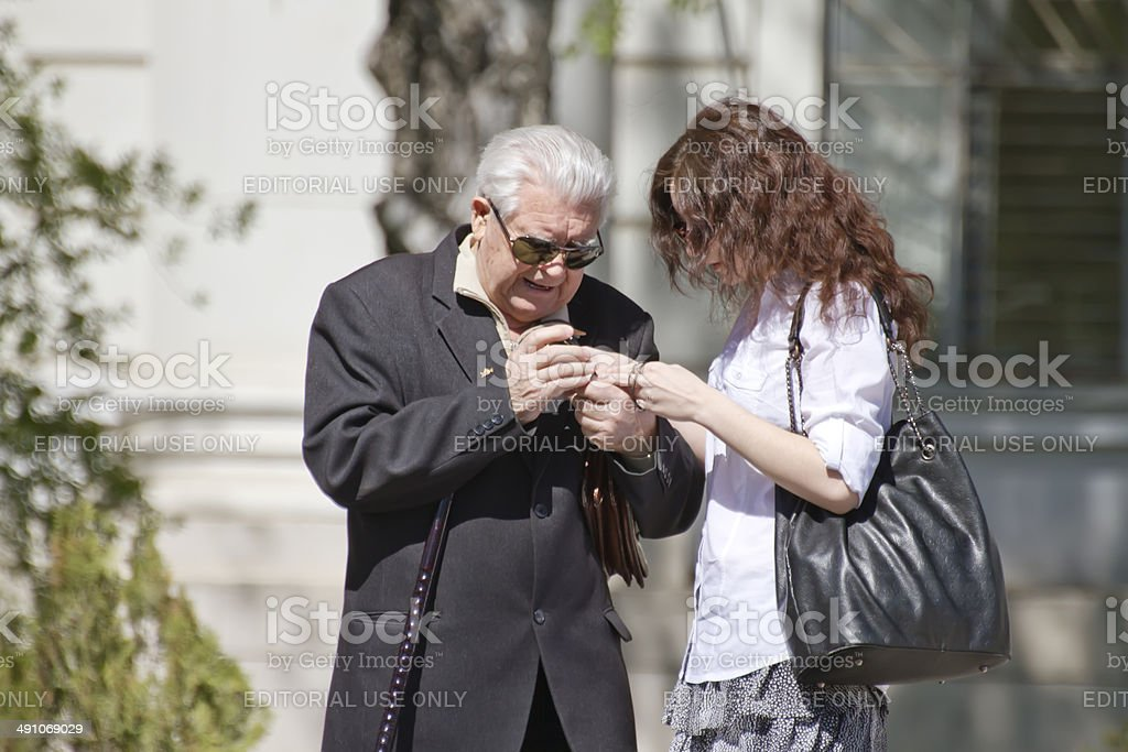 Young girl helps pensioner stock photo