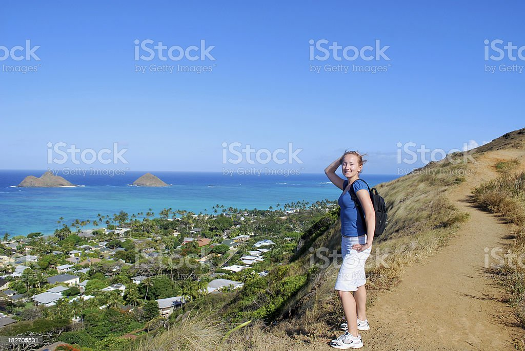 Young girl hiking up the mountain trail in Hawaii royalty-free stock photo