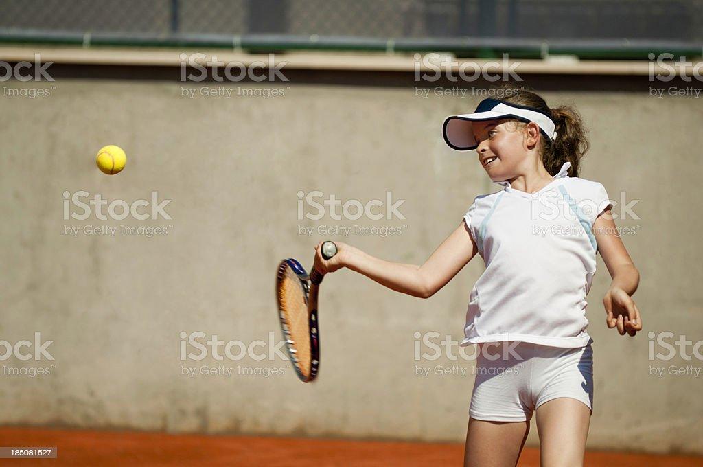 Young girl hitting forehand stock photo