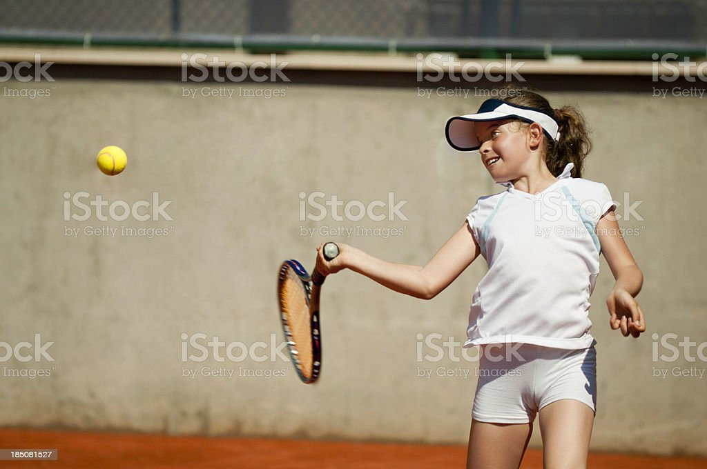 Young girl hitting forehand stock photo