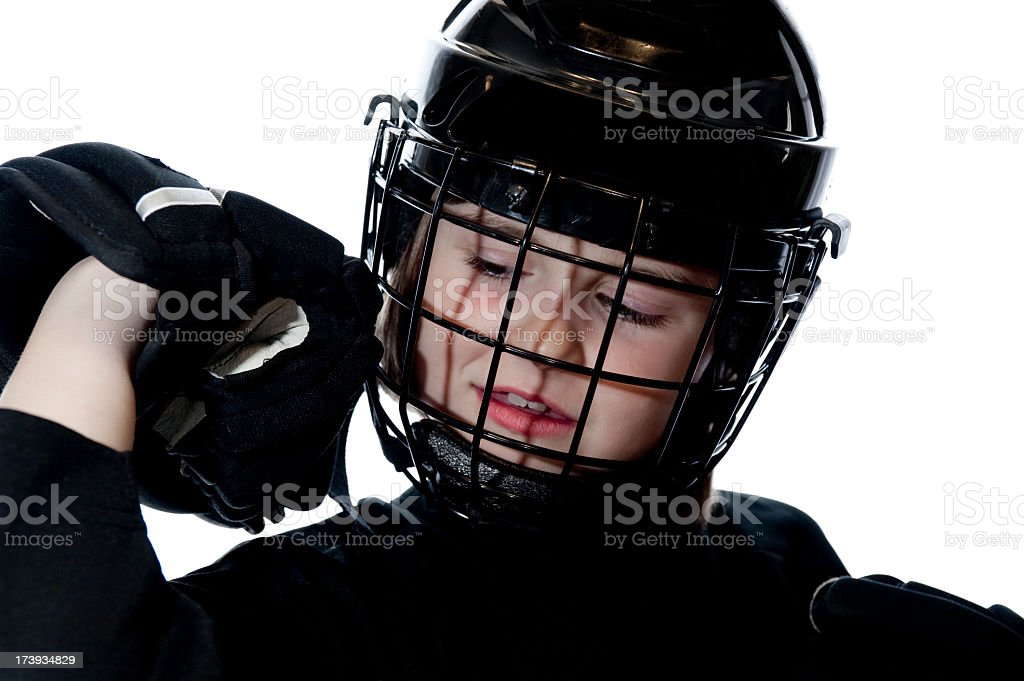 Young girl hockey player in black royalty-free stock photo