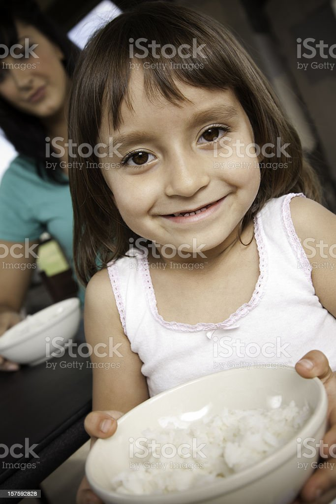 Young Girl Holding a Bowl of Rice. Relief Theme. stock photo
