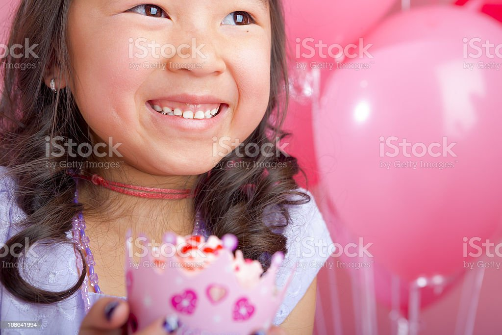 Young girl holding a cupcake royalty-free stock photo