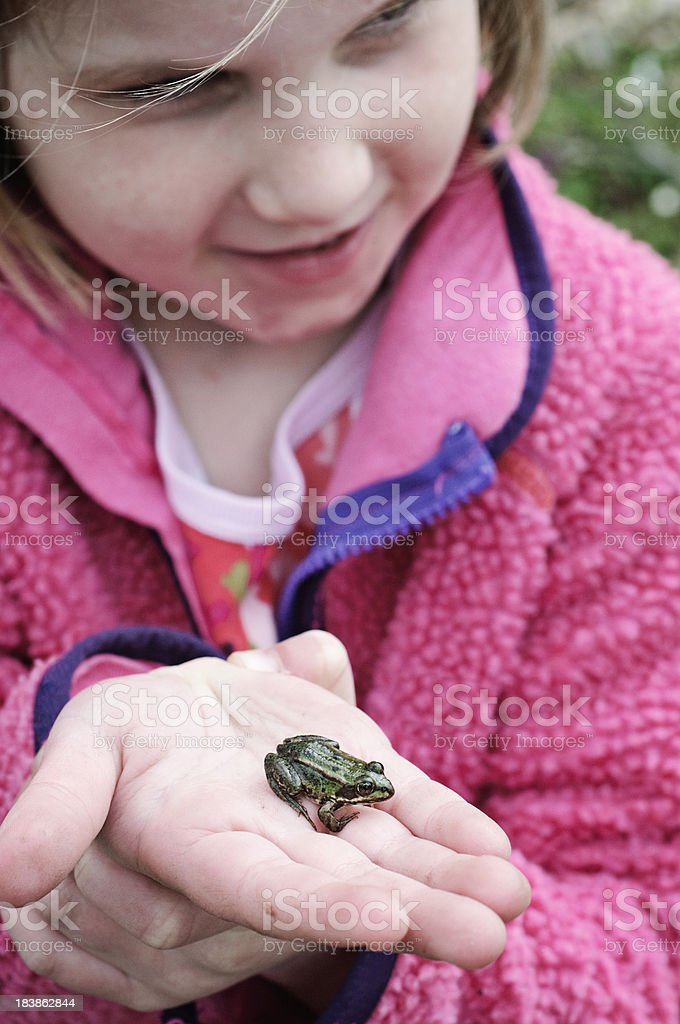 Young Girl Holding a Frog royalty-free stock photo