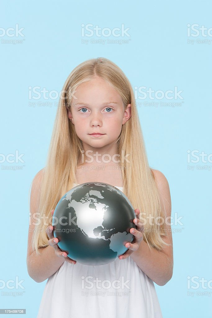 Young girl holding a silver globe stock photo