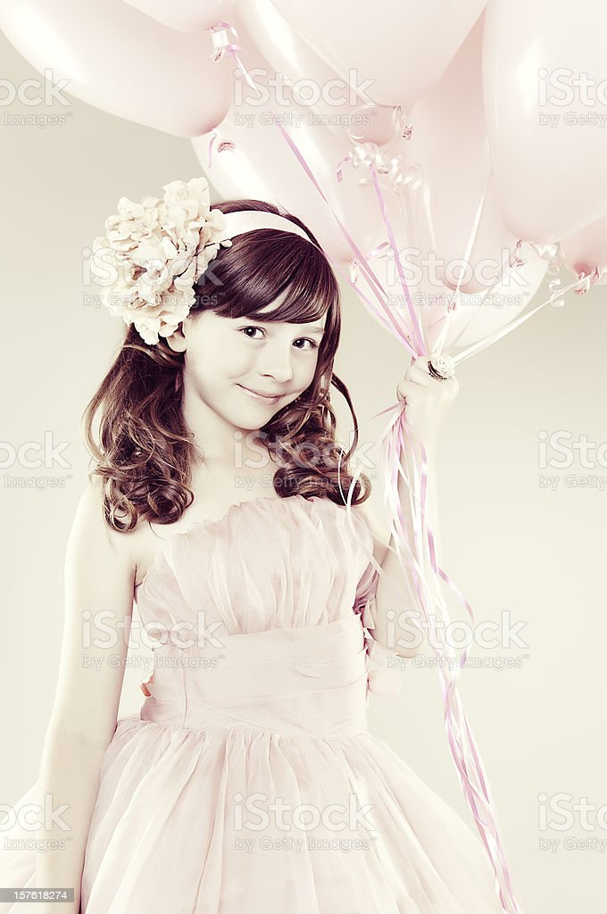 Young Girl Holding Balloons stock photo