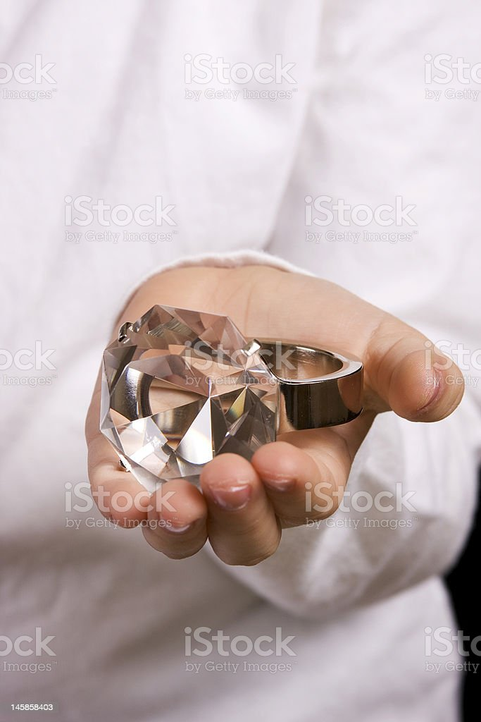 Young Girl Holding Big Ring royalty-free stock photo