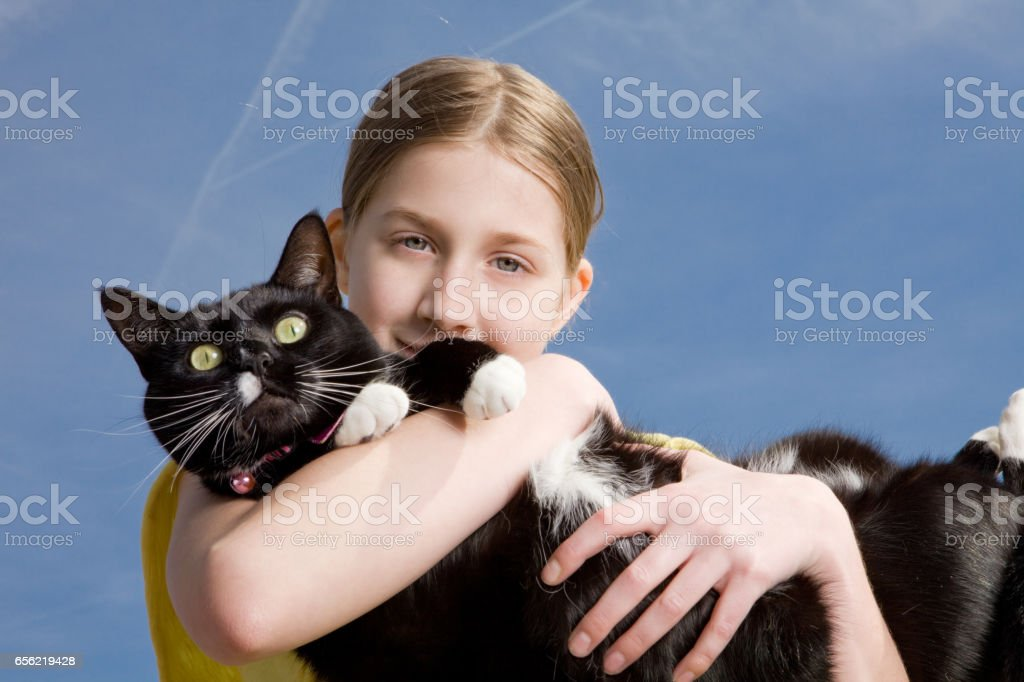 Young Girl Holding Her Cat stock photo