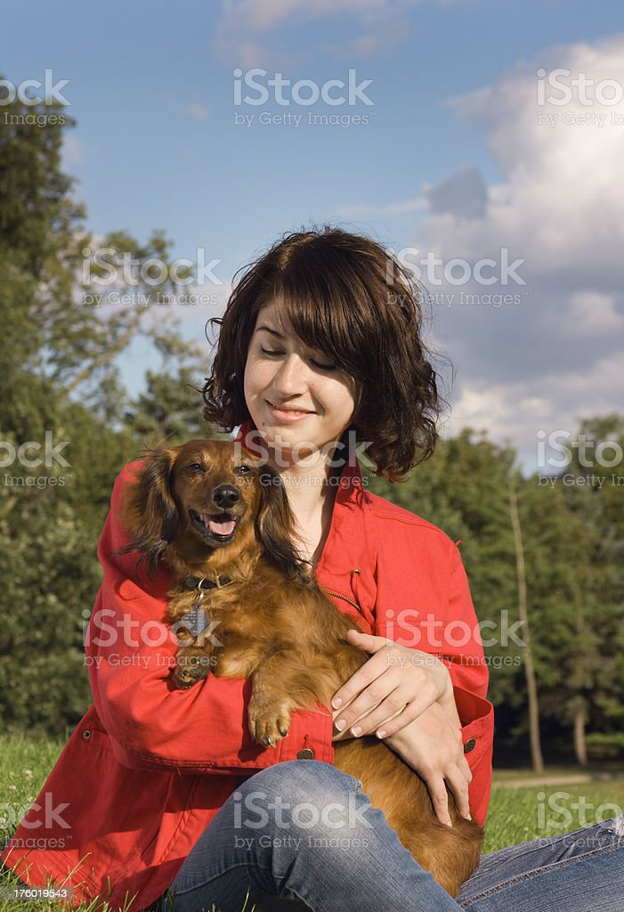 Young Girl Holding Her Dachshund royalty-free stock photo