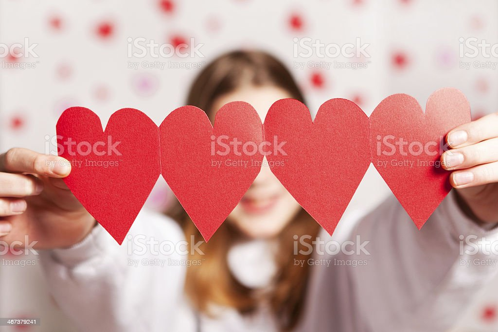 Young Girl Holding Paper Hearts royalty-free stock photo