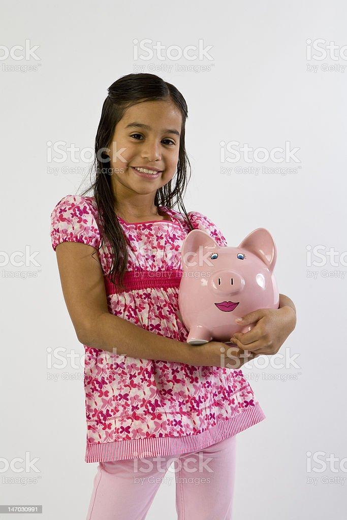 Giovane ragazza holding Salvadanaio a porcellino foto stock royalty-free