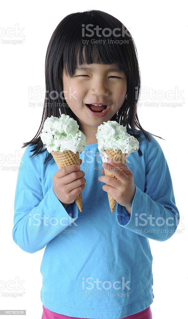 Young Girl Holding Two Ice Cream Cones stock photo