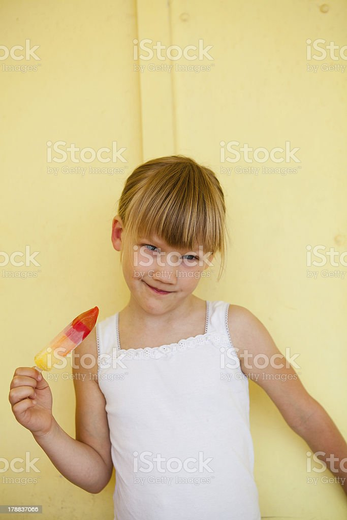 Young girl holding with popsicle royalty-free stock photo
