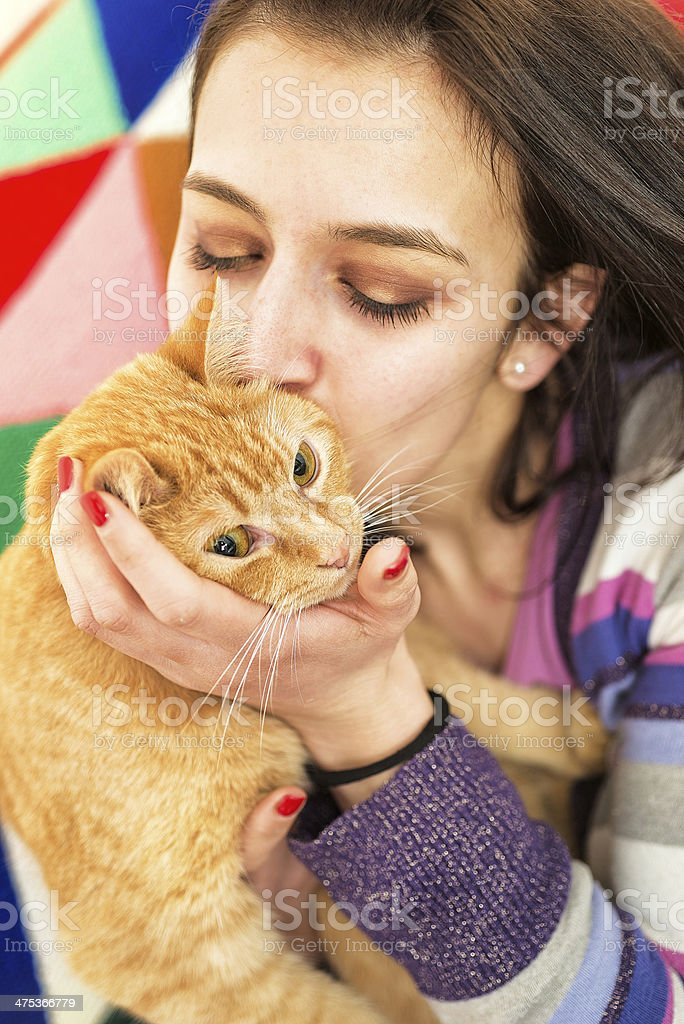 Young Girl Hugging a cat stock photo