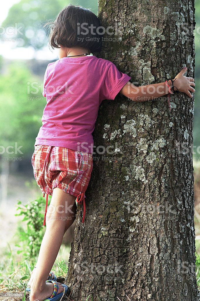Young girl Hugging Tree royalty-free stock photo