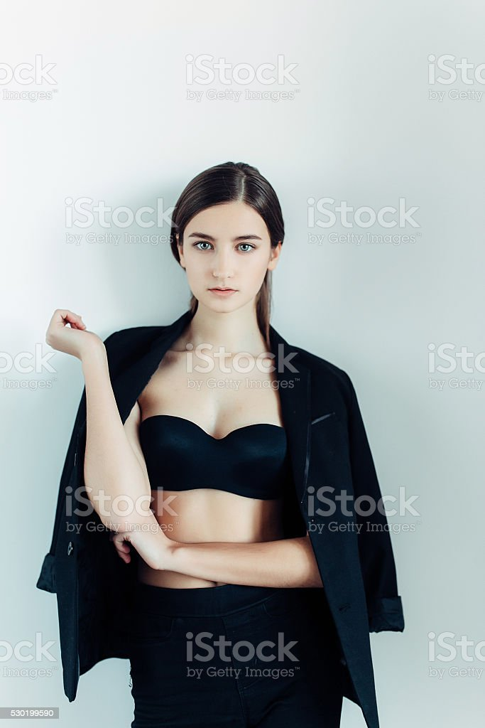young girl in a black dress stock photo